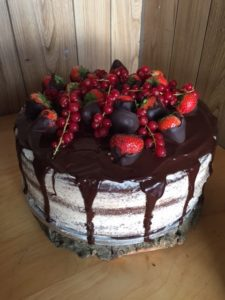 Vanilla and chocolate cake, choclate drip with seasonal fruit