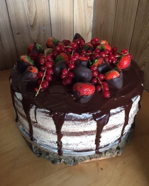 Vanilla and chocolate cake, choclate drip with seasonal fruit
